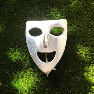 Silver brooch.